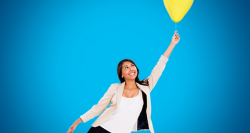 Woman with balloon floating up